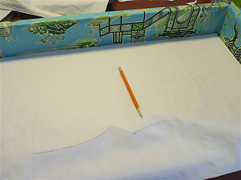 draw around the bottom edge and then cut above the line