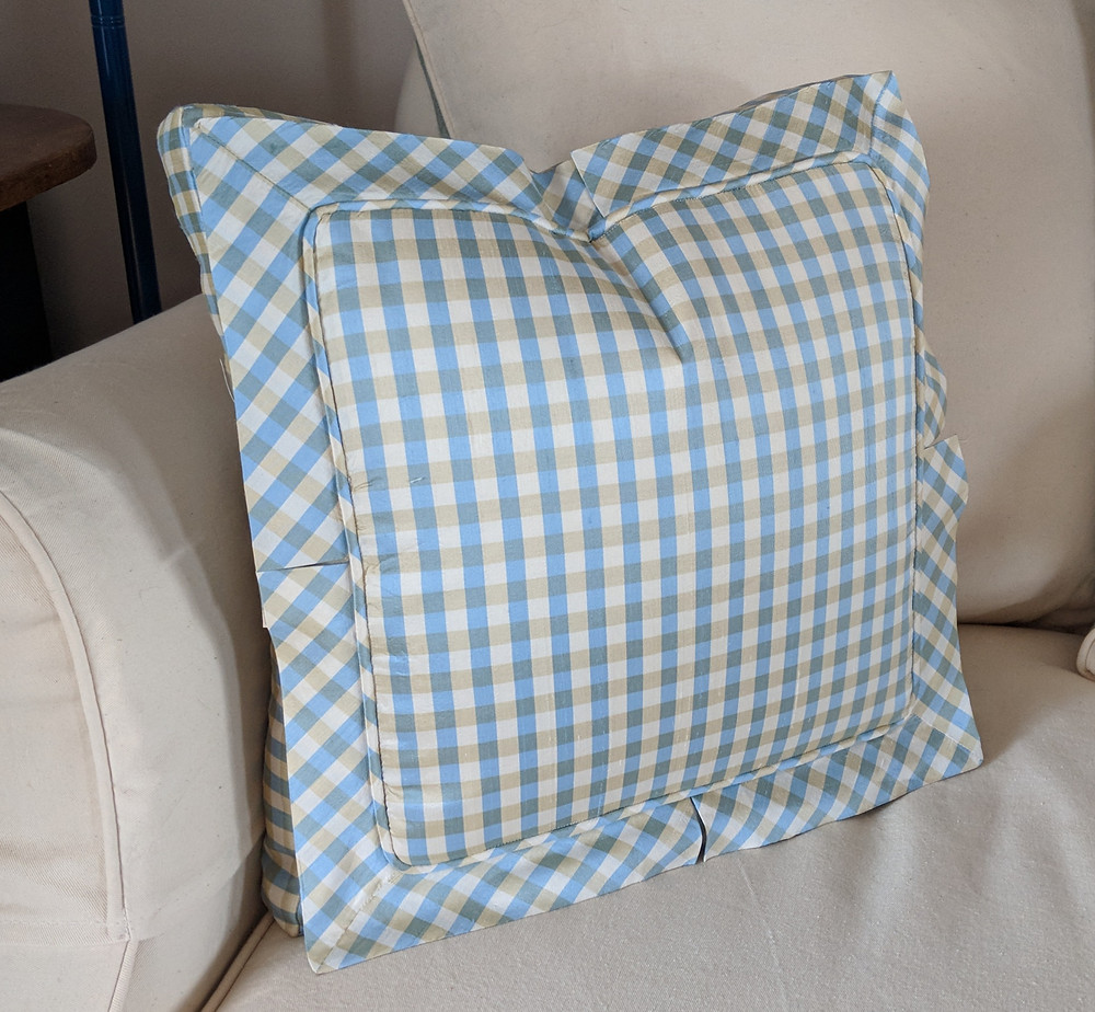 Pleated flange pillow with bias cuts