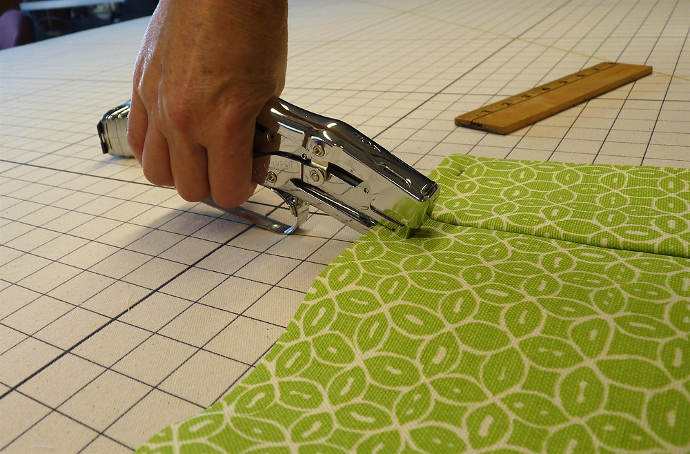 A fabric stapler is used to hold together the fabrics at the top.