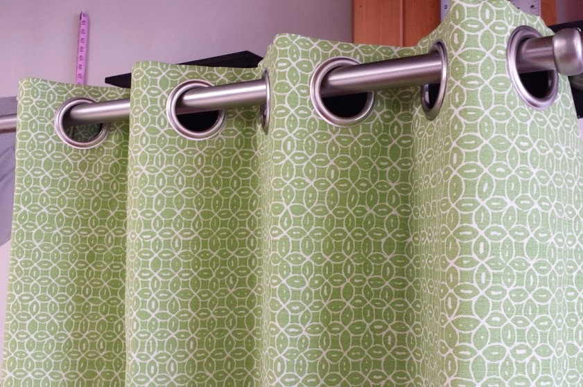 drapery panel with metal grommets