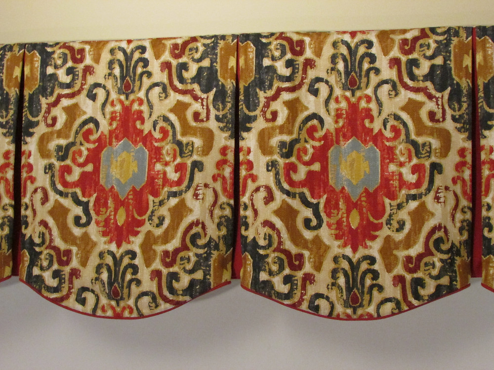 A box pleated valance with centered pattern motif