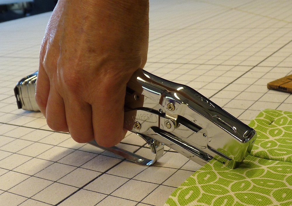 a fabric stapler is a helpful tool in the workroom