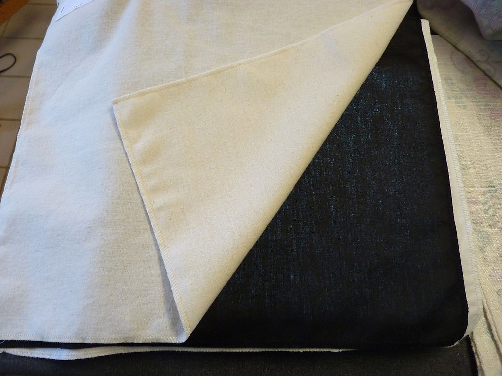 black sateen is sandwiched between the outer lining and the interlining