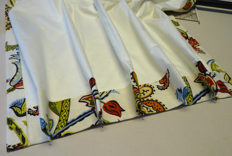 Inverted pleats are sewn with the fullness to the back.