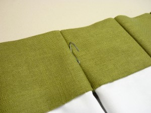 insert drapery pin hooks into the seam on the back