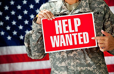 Soldier_ Female Soldier Holding Help Wanted Sign.jpg
