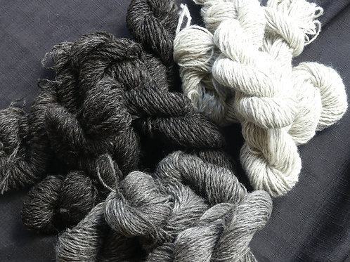 Light white with lighter grey fleck 8 ply 50g