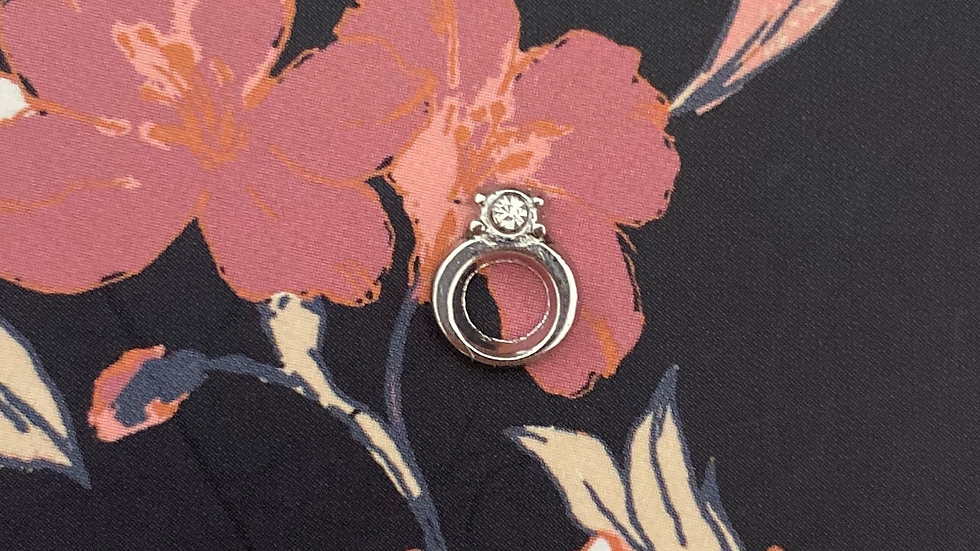 Silver ring charm