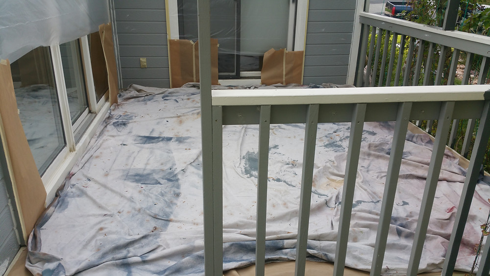 Masking, taping and preparing the surface for new paint.