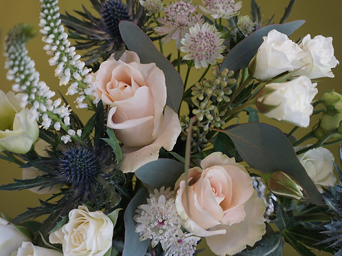 Soft and dreamy pastel bouquet of seasonal flowers.