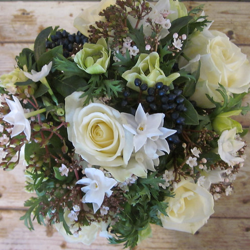 Classic white bouquet of the best seasonal flowers.