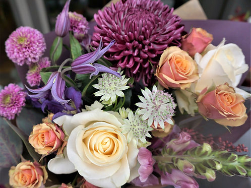 A sophisticated mix of apricot, burgundy, pinks and cream. Prices from -