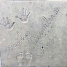 Marilyn Chambers' hand and footprints outside the Pussycat Theater, West Hollywood, 1980