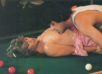 Marilyn Chambers and David Morris in the pool table scene from Insatiable, 1980