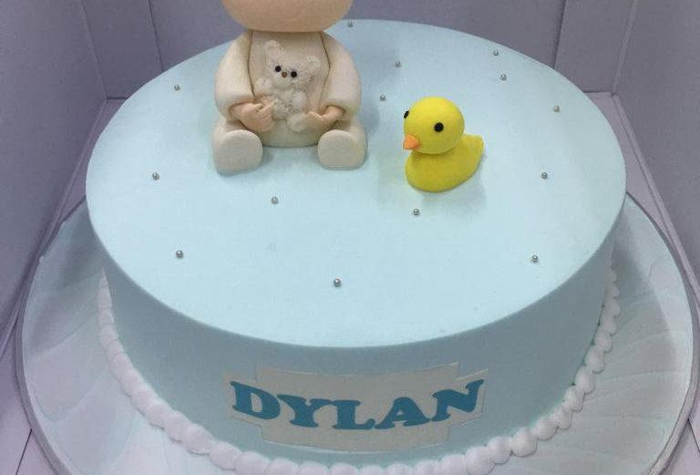 fondant baby boy and duck with fresh cream cake