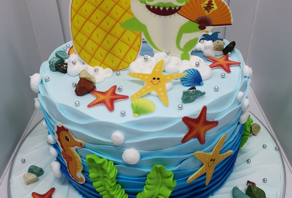 granpa shark with party hat and pineapple cake