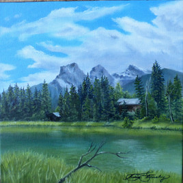 'Cannore in Summer $135.00CND unframed 10x10 oil on gallery wrapped canvas My goal when I paint is to try to capture the handiwork of the master creator. The three siters mountain range in Canmore is well loved and painted by many I hope this painting can transport you to the warmth and beauty of Canmore in Summer The sisters are named Faith Hope and Charity so  1 Corinthians came to mind right away while painting this pretty number