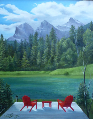 """'The Invitation"""" $450.00 CND Framed 16X20 oil on canvas framed in basic black gallery frame As I visited the nearby town of Canmore AB I was once again impressed by the beauty of our land. I took the photo of the three sister mountain range right in town but took artistic license by adding the dock and chairs as I felt God saying  to me, come rest in Him. By adding the chairs I hope you the veiwer are captivated to take a moment to come sit ,rest and soak up Gods creation. Psalm 49:16 But may all who seek you rejoice and be glad in you. May those who love your salvation say Great is the Lord."""