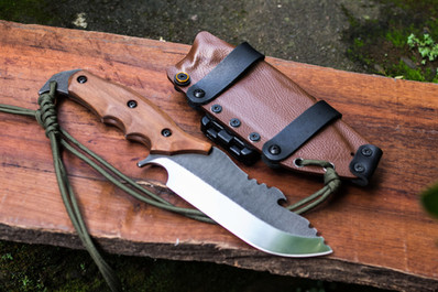 bushcraft drop-point blade with wood handle