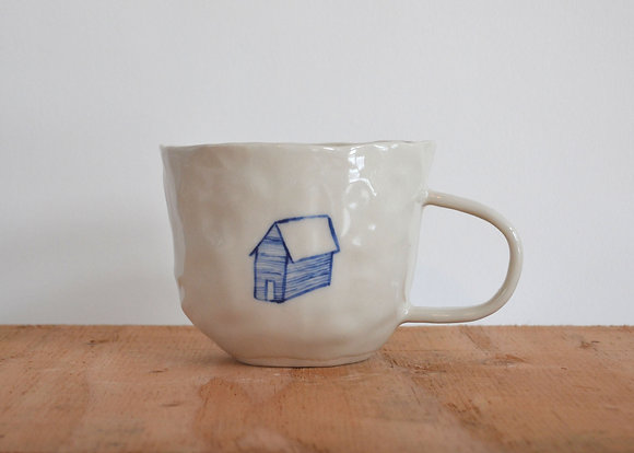 house and hands mug