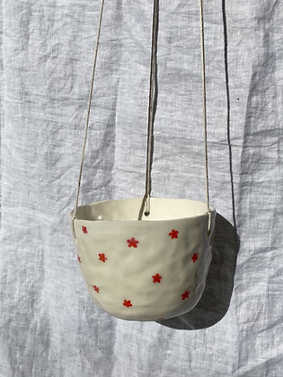 red flower power hanging planter