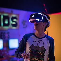 man wearing Sony PlayStation VR_edited.jpg