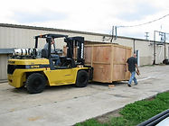 Forklift moving wood crate