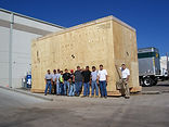 Crating crew with large custom wood crate