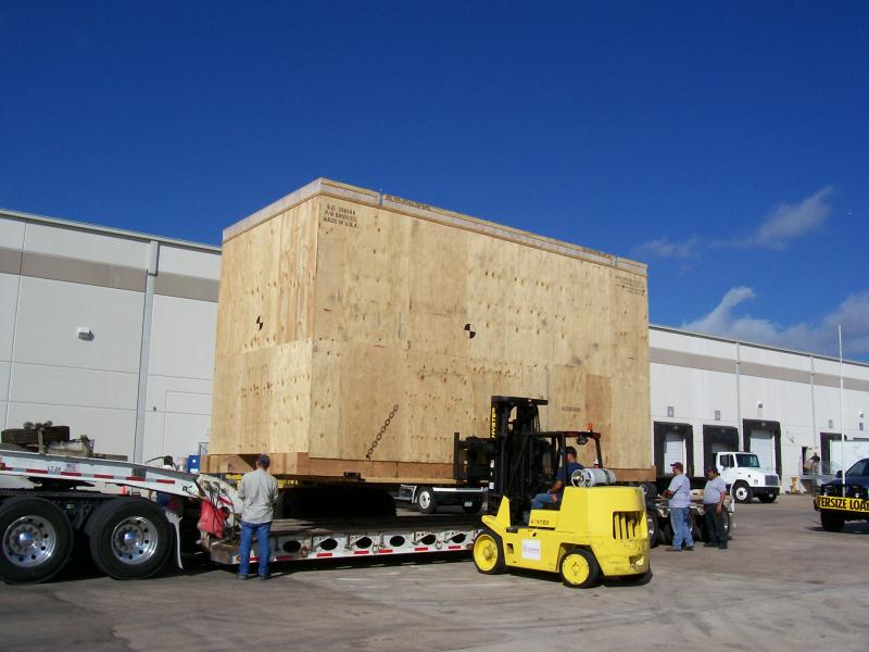 large crate loading onto trailer