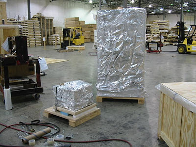 Custom skid pallets and barrier bags