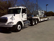 Lowboy trailer with heavy equipment