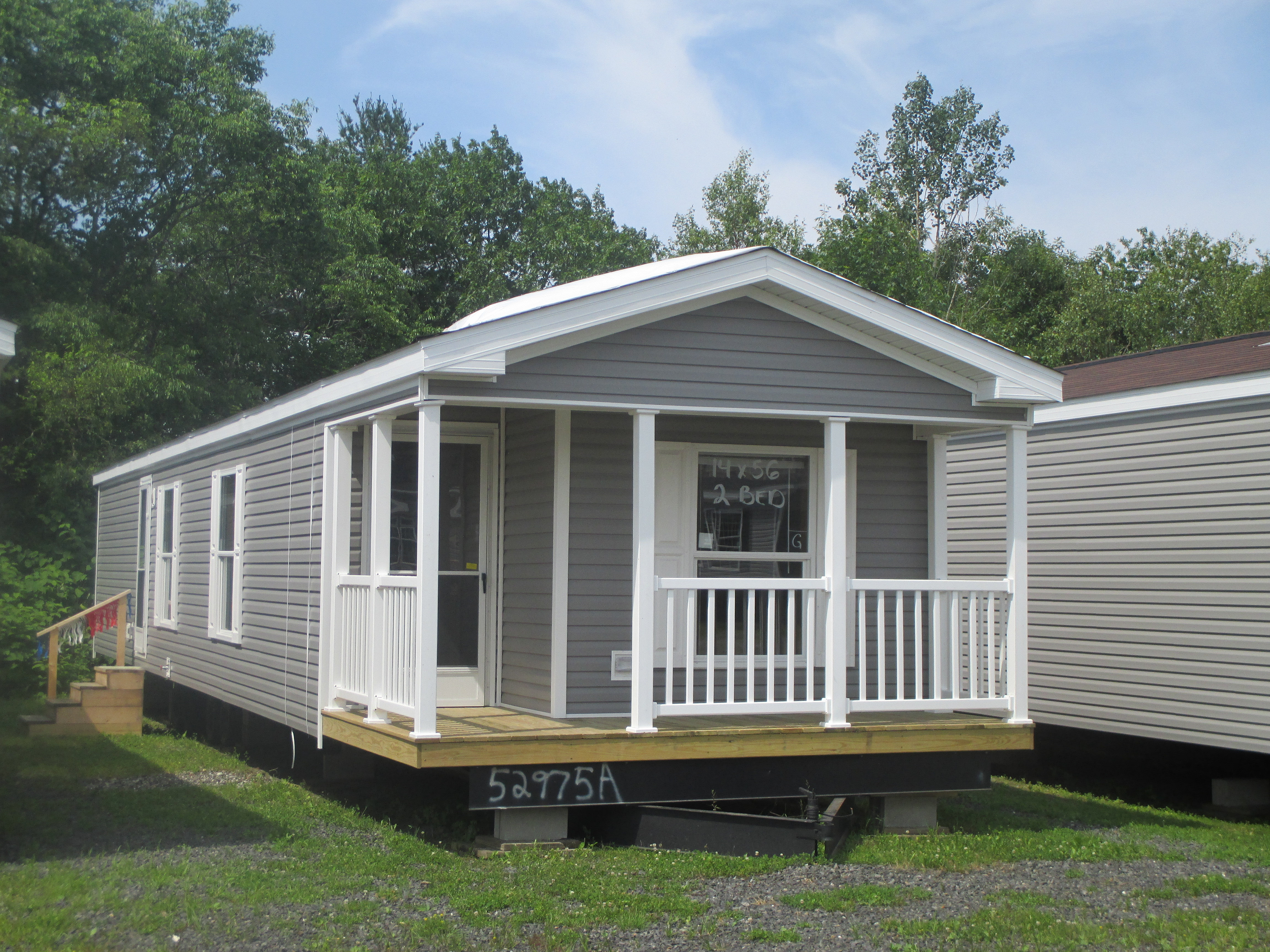 Maine manufactured mobile modular dealer boggs homes for Single wide mobile homes with front porches