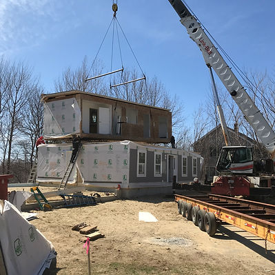 Colonial being craned on cellar