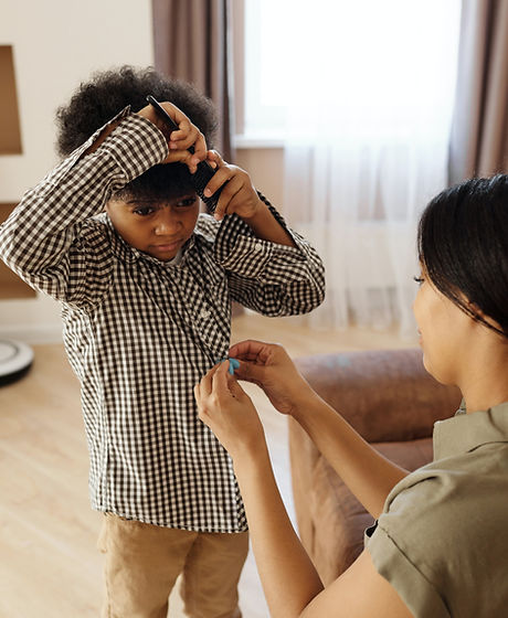 mother-helping-her-son-to-get-changed-42