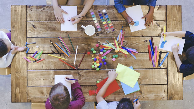 Aerial-view-of-kids-doing-arts-and-crafts-1162045337_1369x770.jpeg