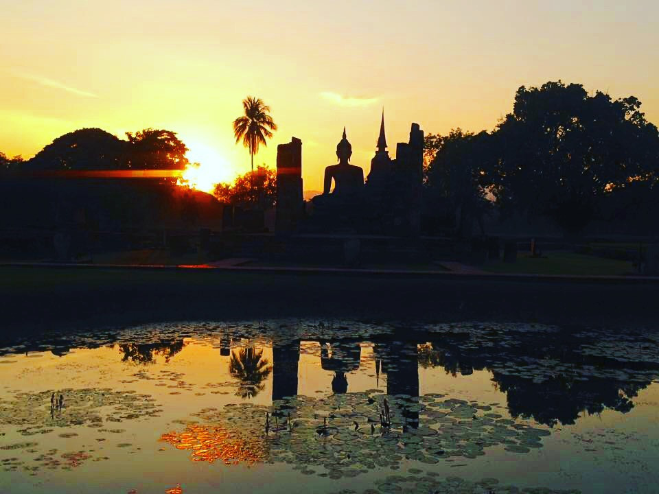 Watching the sun fall inside Sukhothai Historical Park, Thailand