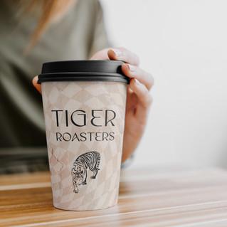 Coffee-Cup-with-Hand-Mockup copy.jpg