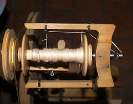 Spinning silk Acacia-colored