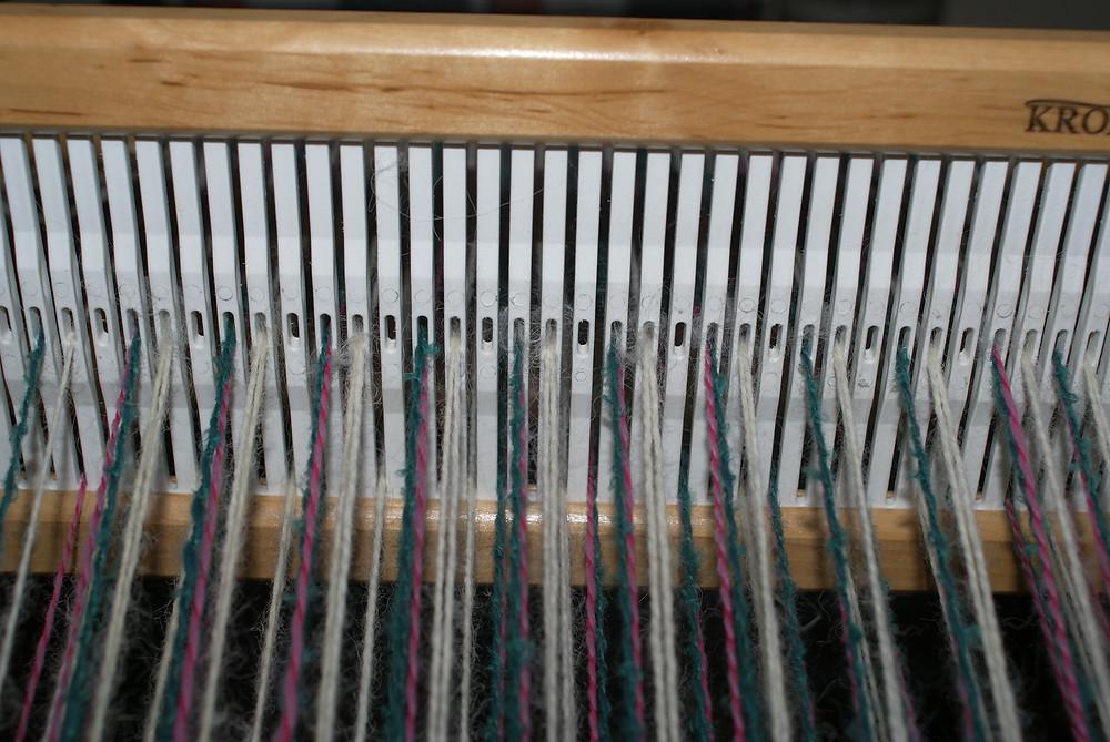 détail chaine montée sur métier peigne rigide