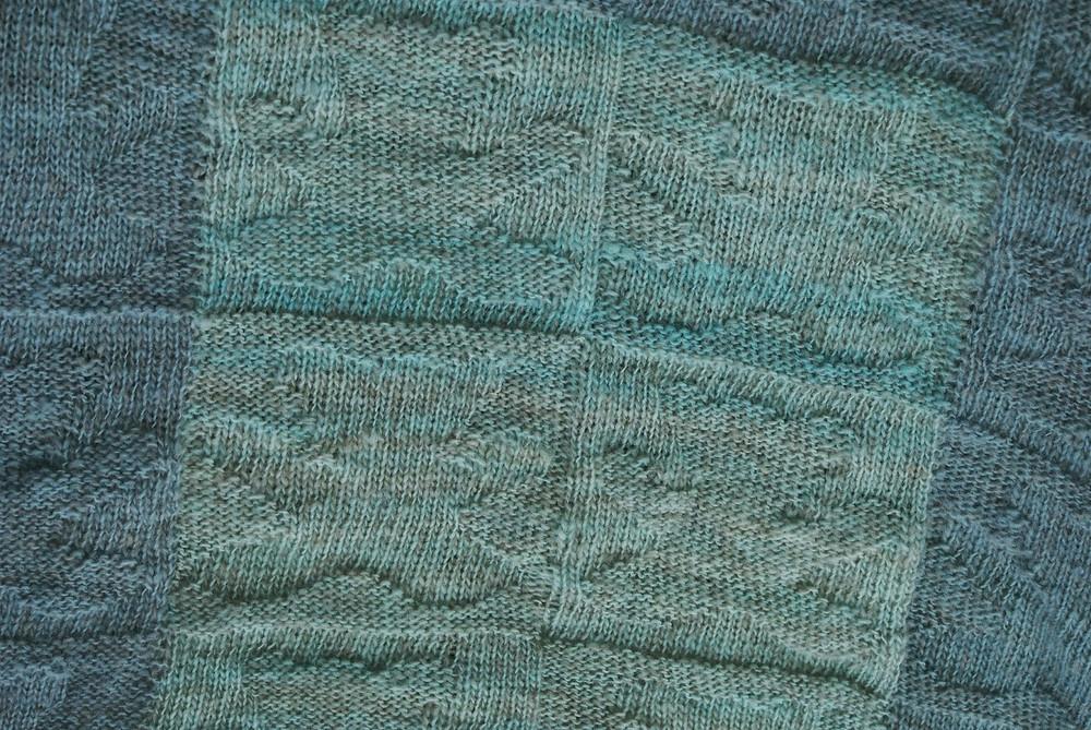 couverture tricoté laine bleue alimentaire