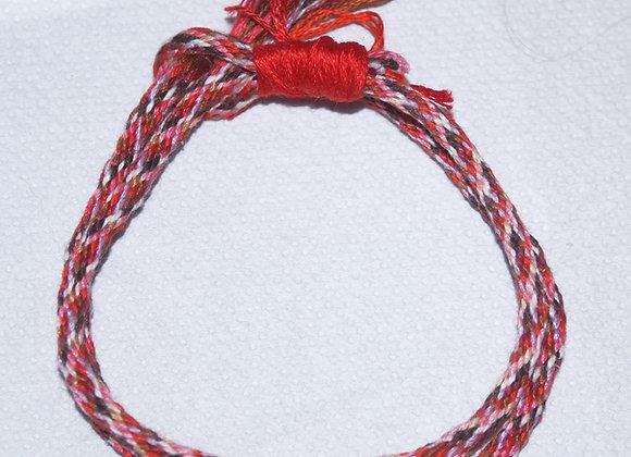 Bracelet cordon tissage japonais aux nuances de rouges