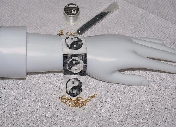 Bracelet perles tissées yin yang noir blanc