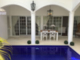 View of pool, ourdoor dining room and en