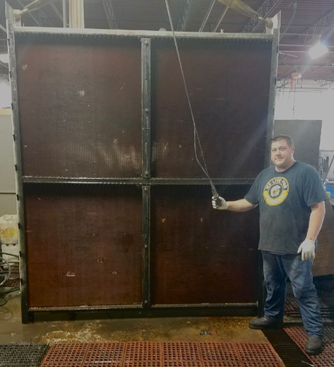 Big or Small we fix 'em all: Our technician Eric with a small re-core job.