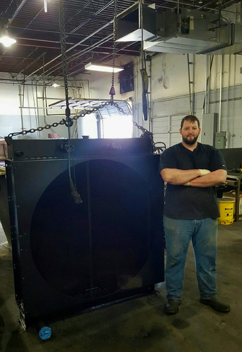 Big or Small we fix 'em all. Our 6'4 technician Jacob standing next to a recore job.