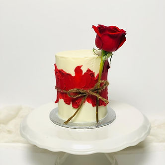 mini valentines day red and white buttercream cake with fresh rose