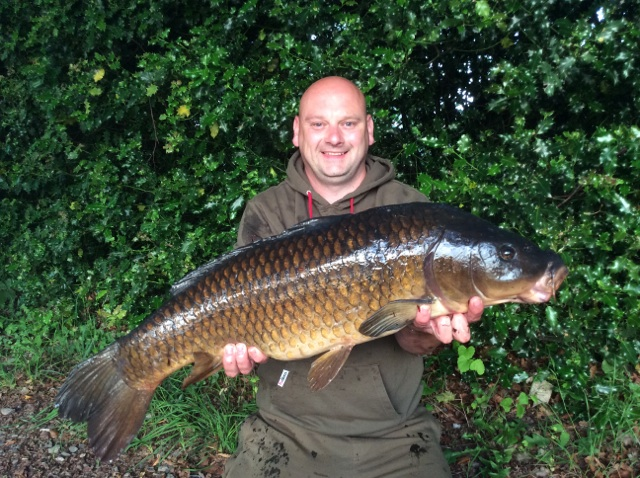Jason with a nice canal common carp