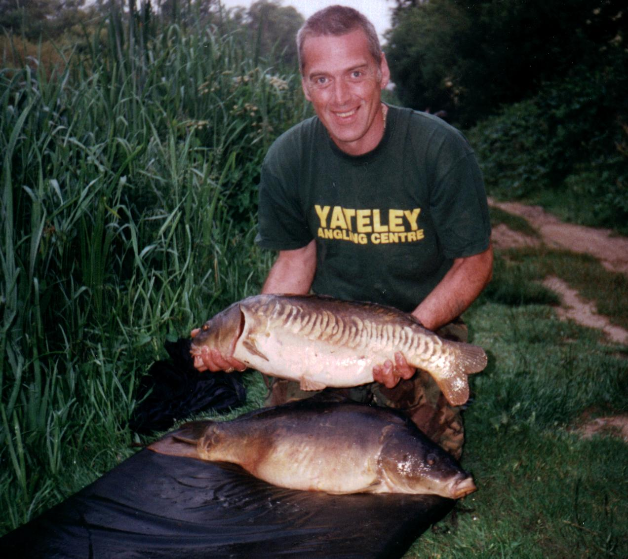 Gary Goddard with two carp 19lb & 18lb 6oz
