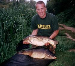 Gary Goddard with two carp 19lb & 18lb 6oz
