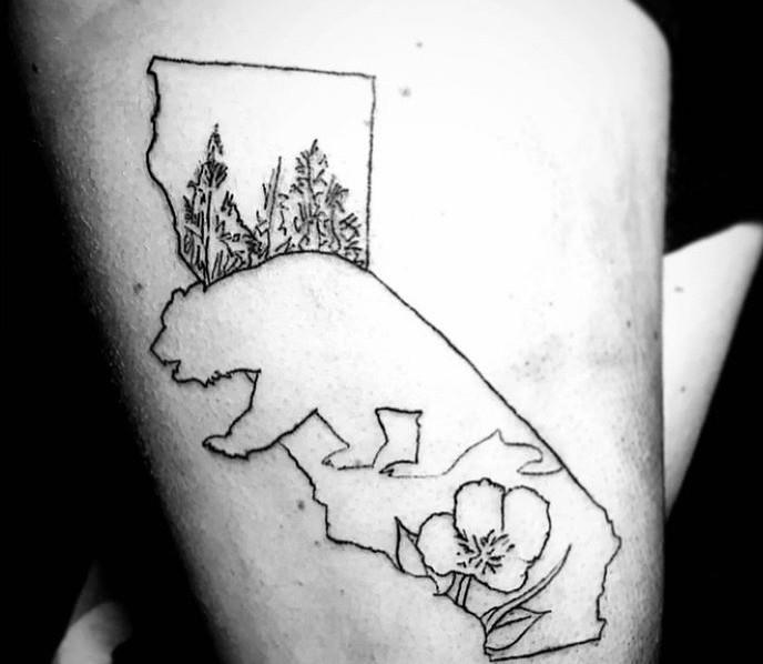 cali tatt on a friends thigh